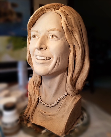 Bust of a smiling woman