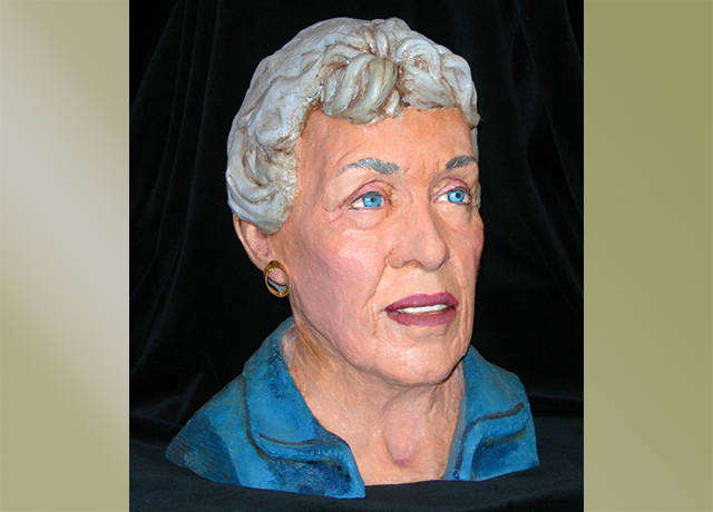 Sculpture of a woman painted realistically